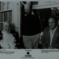 Black and white photograph showing John Huston, Wieland Schulz-Kiel and Chris Slievernich on the set of